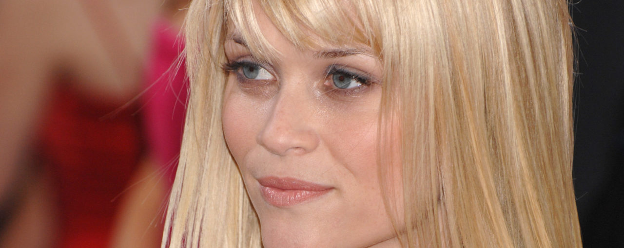 Reese Witherspoon With Very Light soft Auburn Base & Tons of highighted tones from  colors like vanilla to maple syrup looking.