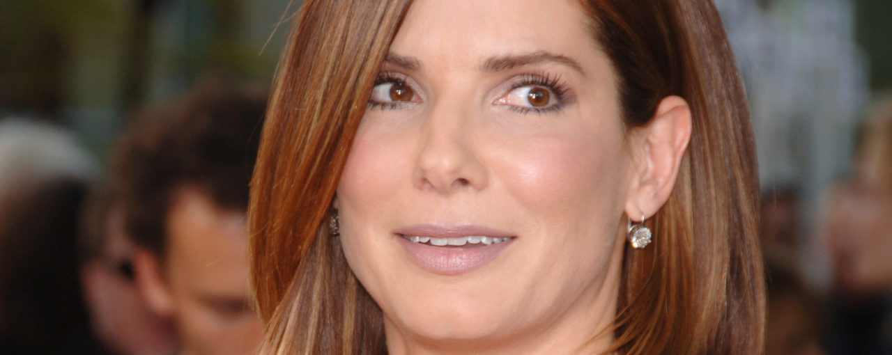 Sandra Bullock smooth just touching shoulders soft auborn looking brunette | slightly bronze highlights