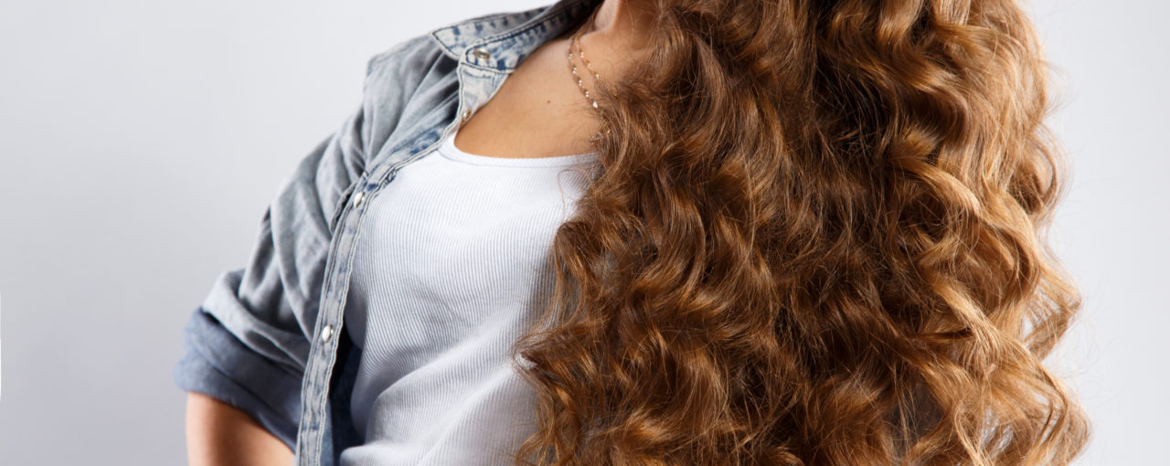 Past mid-back length Naturally medium curly hair