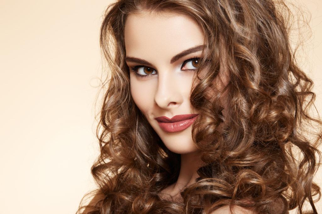 Caramel Highlights On Medium Brunette Hair Natural Looking Curls On