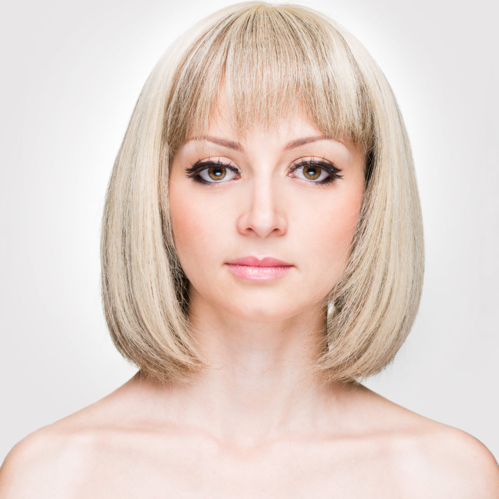 Above shoulder length graduated bob wispy bangs Medium blond with lots ash blond highlights ...