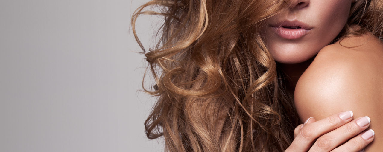 The long layered cut is fashionable with the medium curls done with an iron.
