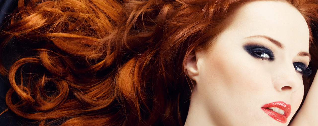 Beautiful natural looking red hair color on large bouncy curls