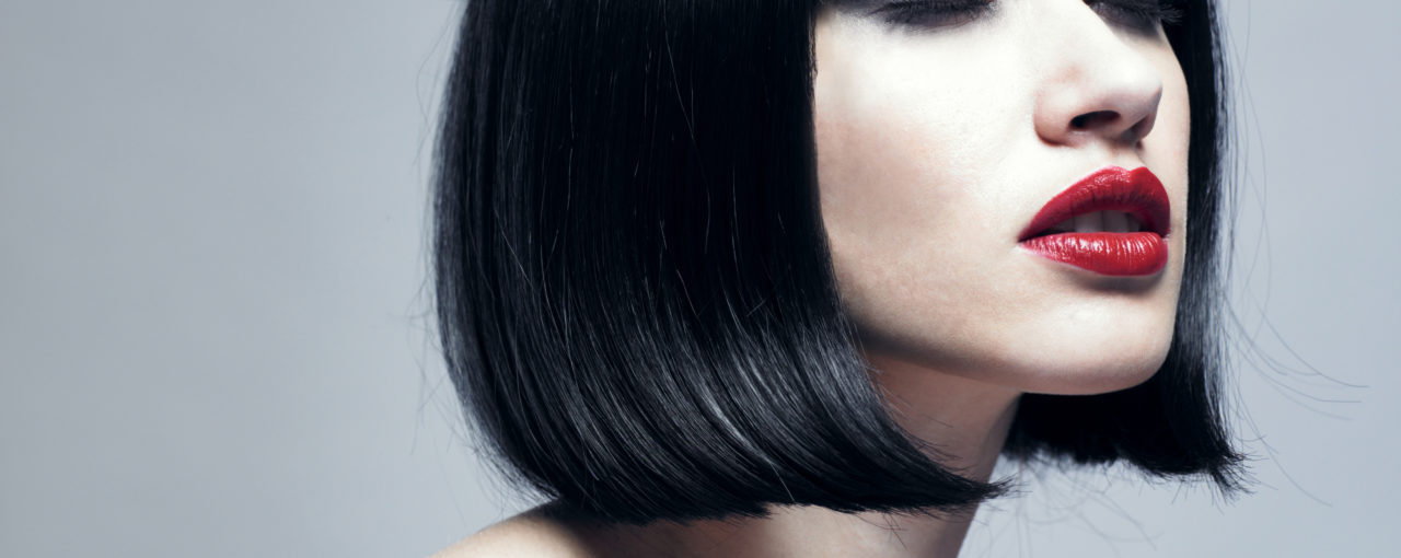 This is a retro haircut from the 1960s era.  Slick sleeky glosss black hair color.