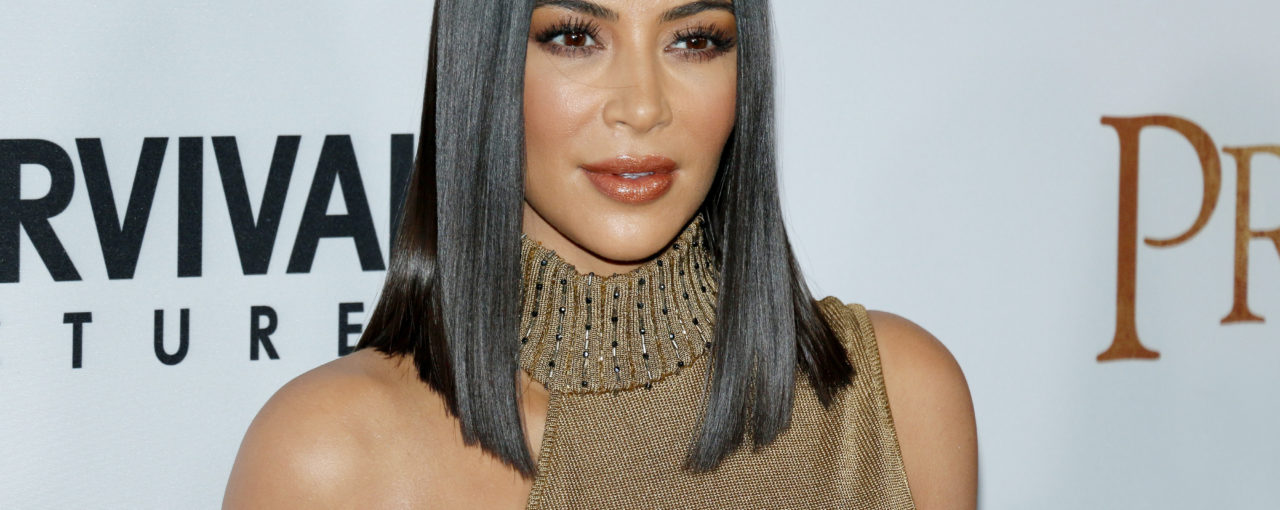 Kim Kardashian - Sleek straight black lob hairstyle.