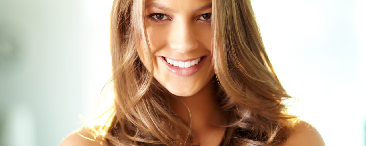 blowout with round brush on light natural brunette.  Subtle golden blond balayage hair color
