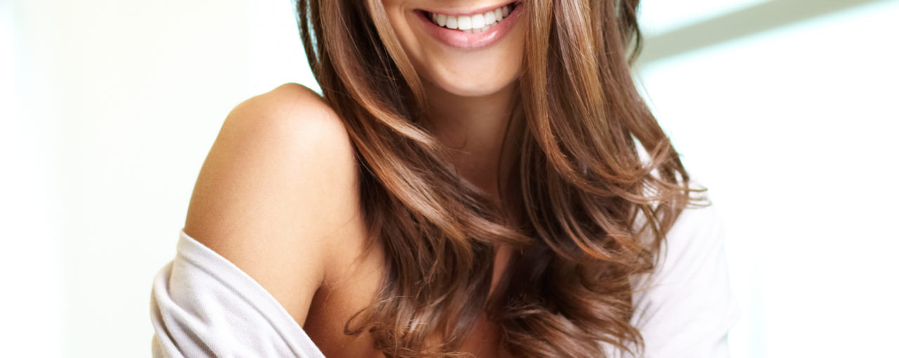 Long framing layers light brunette hair color done with beach waves