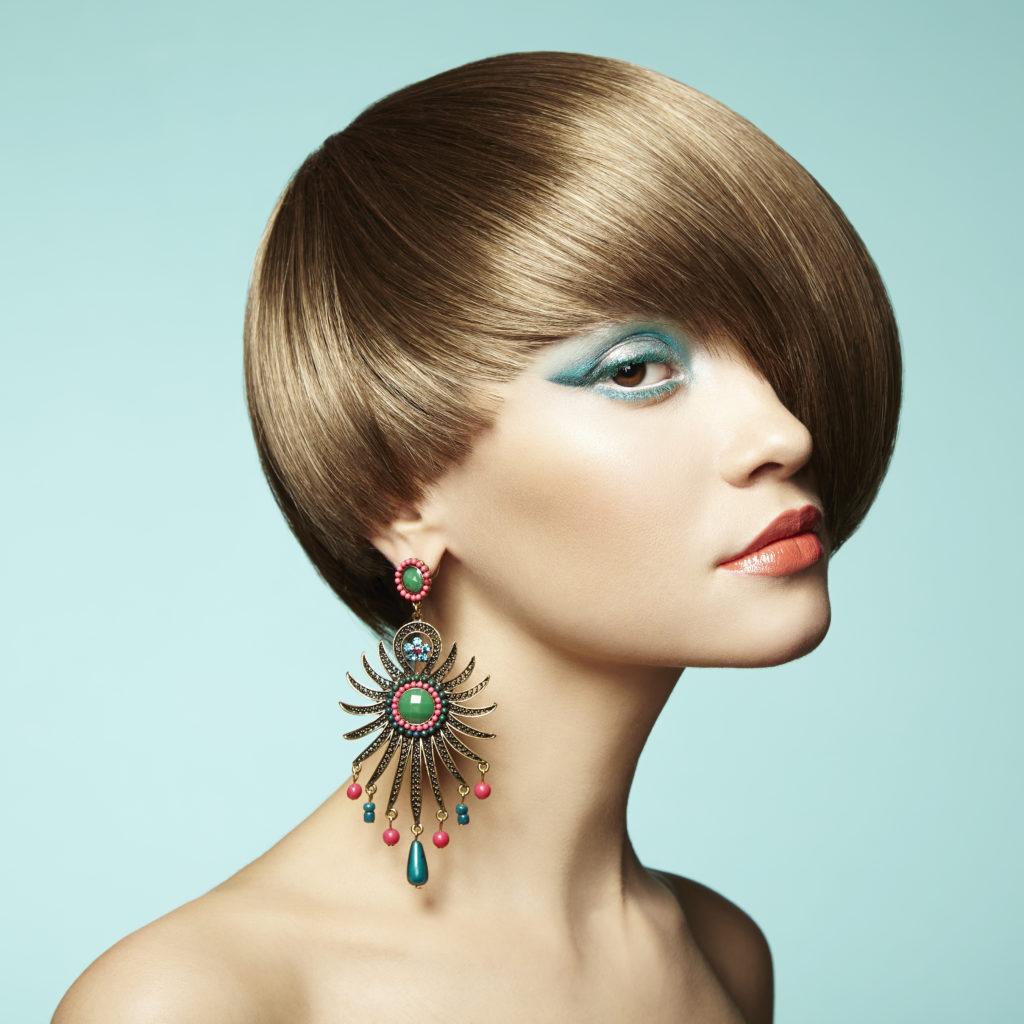 best retro 1960s era vidal sassoon haircut in darkest solid